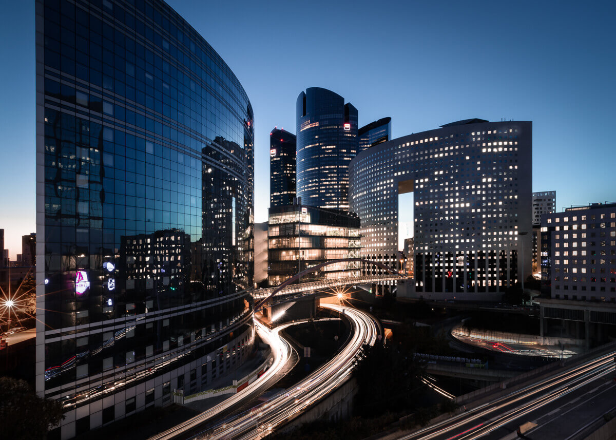 sunset in La Défense Paris with light trails fine art photographs by yaopey